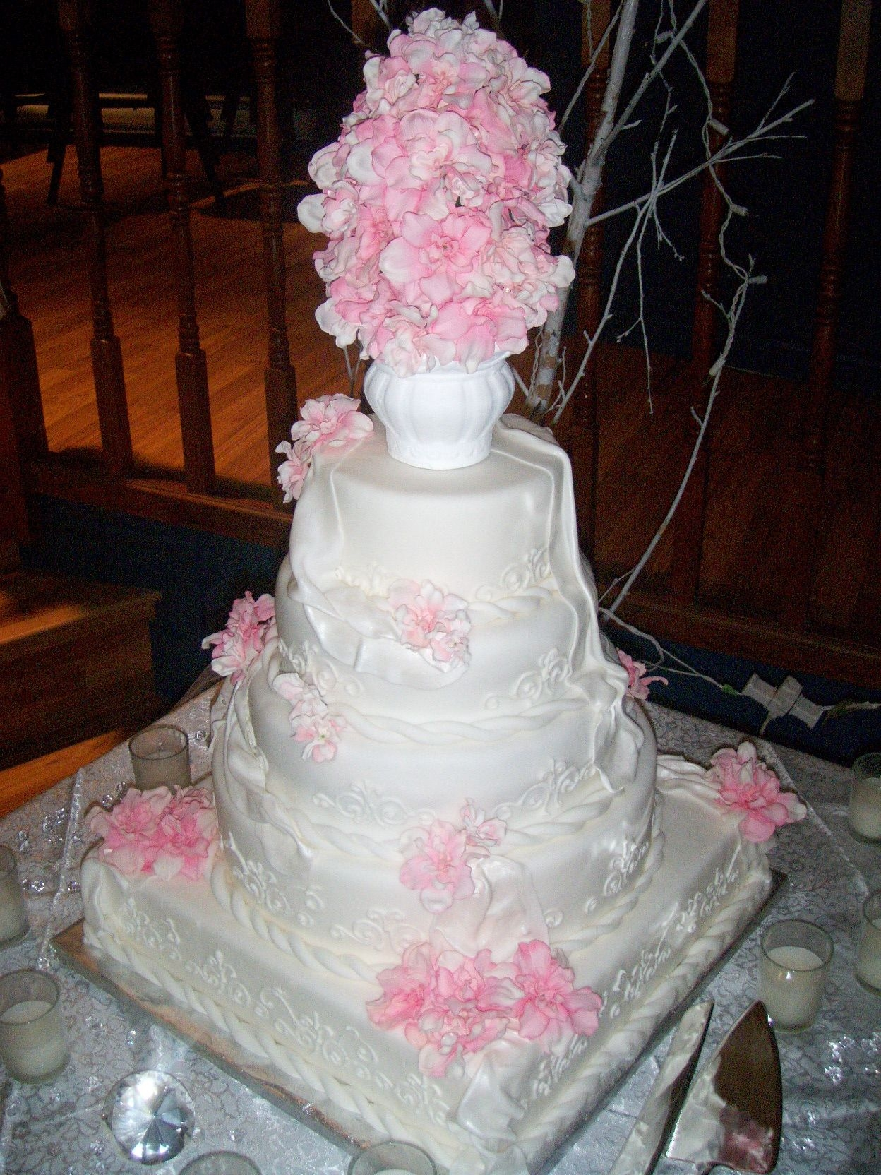 Pink And White Wedding Cake Bride wanted 5 layers, 1 square, 4 round.It came out better then I thought. All she said was that she wanted pink flowers and some piping,...