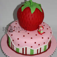 Strawberry Shortcake Strawberry is carved cake, all fondant. Flavours are banana cream and strawberry.