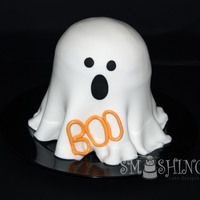 Ghost A Ghost cake for my kids daycare. I struggled a bit with the ruffle at the bottom as the fondant just kept stretching and getting longer...