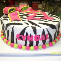 21 Zebra buttercream w/ fondant zebra stripes and bow.