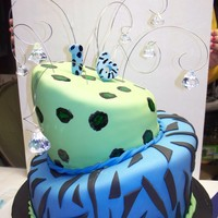 "Sweet 16 First attempt at a ""topsy turvy"". It turned out ok, I think. Vanilla cake with caramel filling. MM fondant."