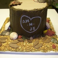 "Tree Stump Cake was to replicate how the wedding couple met while hunting. Both are big hunters. buttercream on ""stump"", fondant leaves and..."