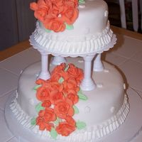 2 Tier Cake   cake covered in fondant. the roses are made of fondant and took a long long time to make.