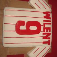 Phillies Jersey Made this for my nephews 9th b-day. 11x14 cake and 8x8 cake cut diagonally for the sleeves. Covered in MMF