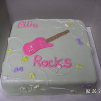 Electric Guitar Birthday Cake This was for a friend's birthday. I covered it in rolled butter cream. The vines and butterflies are in royal icing and the guitar is...
