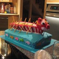 Dragon Boat Cake Made for a dragon boat BBQ party. Boat is made from rice cereal treats, BC, and MMF. Cake is chocolate and covered in BC.