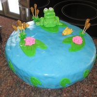 Froggie In The Pond Cake  This is my first time using MMF and making a fancy cake like this. The inside is chocolate cake. The decorations are made with fondant and...