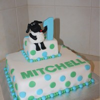 Happy 1St Birthday Mitchell Timmy Time CakeWhite Chocolate Mud cake covered in fondantTimmy made from fondantMade by Jess & Deb