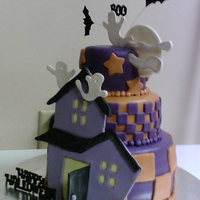 Spooky Hills Covered in fondant. House, ghosts, moon and clouds are gumpaste. I cheated and used foam bats, pumpkin, and letters!!! But the house was...