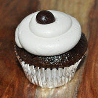 Chocolate Espresso Cupcake Espresso infused chocolate cupcake lightly glazed with an espresso liquer glaze. Frosted and filled with an espresso infused whipped cream...
