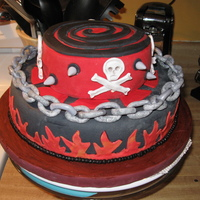 Black And Red Skull Cake This cake was a learning experience. Never color your own black and red fondant!! I couldn't tell you how much coloring I used on this...