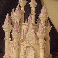 "Fairy Tale Princess First Birthday Cake 10"" and 6"" tiers, Wilton's castle cake turrets."