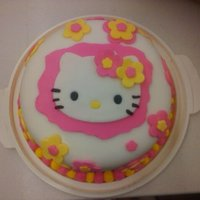 Hello Kitty - Final Cake In My Fondant Class First Fondant cake. Strawberry cake, iced in BC covered in fondant w/ fondant decorations.