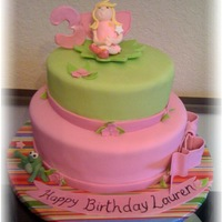 "Fairy Princess Cake This was a fairy princess cake for an adorable little girl turning 3. It's a 10"" and an 8"". Fondant covered with fondant..."
