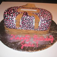 Pink Leopard Print Purse Cake My first purse cake ever! This was a strawberry cake with strawberry filling and buttercream covered with fondant. I intended on making a...
