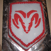 Dodge Ram Cake Covered in grey MMF and the logo is buttercream.