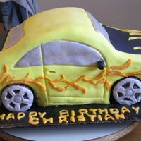 Christian's Car My first attempt at sculpting a car cake. My grandson loved it !!!