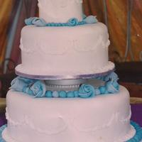 Blue Roses Wedding Cake Three tier round pound cake with fondant covering and fondant roses.