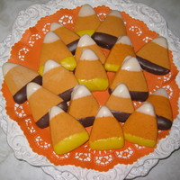 Candy Corn Cookies   My husband made a cookie cutter the size I needed for a Halloween theme wedding. Orange cookie dough, dipped in chocolate
