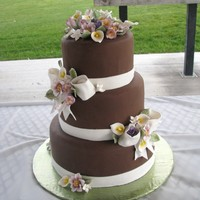 Jessica's Wedding Cake Chocolate fondant covered cakes with gumpaste flowers and bows.