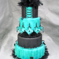 Mardi Cake This was a fun cake with bead, feather, and gumpaste embelishments. I just did this one for fun!