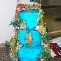 Hawaiian Waterfall This cake is covered in fondant with royal icing and fondant decorations. The cake was airbrushed and the waterfall had piping gel on it to...