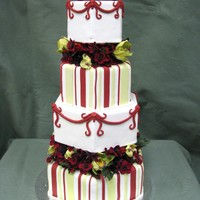 Garden Orchid Cake This is a fondant cover cake with orchids and dark red blossems.