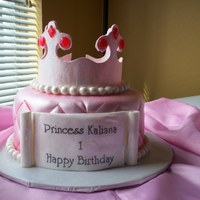 Princess Cake Gum paste crown, gum paste scroll, chocolate cake with raspberry filling, Duff' fondant and lots of disco dust.