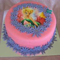 Tinkerbell   Chocolate cake with strawberry buttercream filling, covered in fondant. Flower border inspired by Bluehue.