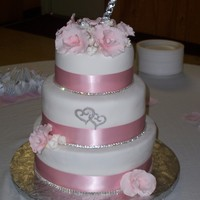 Pretty In Pink  Pink orchids and satin ribbon. Crystal trim. I really thought this cake was pretty until I had to add the heart cut out (cricut cake) that...