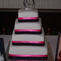 Simplicity  I have done this cake in these colors several times, however this is the first time the bride requested no flowers at all. It was a very...