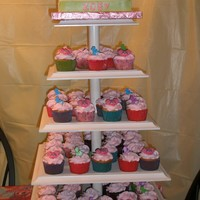 Abby Cadabby Cupcake Tower And Cake  This was for my nieces 1st Birthday. My father in law makes the cupcake towers. The stand looks beautiful with a two tier wedding cake and...