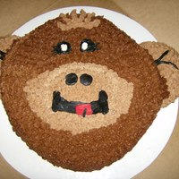 Monkey Face Birthday cake of triple chocolate cake with double chocolate buttercream icing.