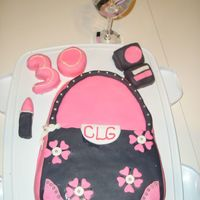 Crystal_Purse_Cake.jpg Chocolate mud cake, covered in BC and Fondant. Another girlfriend of mine and I made this for our friends 30th birthday. It was a first for...