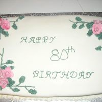 80Th Birthday Cake My Grandmother's 80th birthday cake. Fondant covered with White Chocolate BC leaves and vines. Gumpaste roses. Took a long time to...