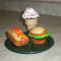 Picnic Food These cupcakes were made for my son's class picnic. They are all buttercream and cake except the hot dog which is rolled buttercream....