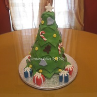 Christmas Tree Cake I made this for my Mother's Christmas Day Birthday! The presents are petit fours : )
