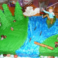 Fishing I made this cake for my dad's 50th b-day. It was red velvet cake, I used buttercream for all the icing. The rocks are candy.