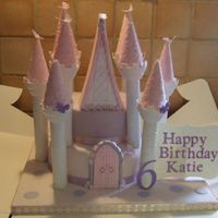 Castle Cake Made for my grandaughter's 6th birthday today. Cake is 2 tiered round madeira. The towers are Wilton and the turret tops, door and top...