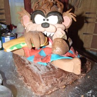 Debbie Brown Cartoon Cake I Made This was for my husband birthday last october. His birthday on halloween, ive never had any experiance with fondant had no idea what it was...