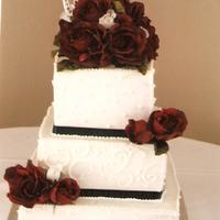 Anniversary Kake Three-tierred blk/red/white square kake.