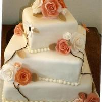 Coral/ivory Wedding Kake Three-tier turned squares with Coral/Ivory roses