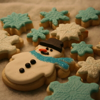 Snowman And Snowflakes Fondant covered sugar cookies. This is the kind of snow I like. You can't slip and fall on it! lol!!!