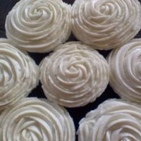 White Rose Swirl Cupcake   just plain and simple swirled cupcakes using a 1M tip.