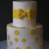 Yellow And White Buttercream iced, 50/50 and gumpaste accents.