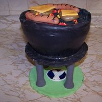 Father's Day Bbq Grill  The hotdogs and cheeseburgers are made of fondant. The cake is 8 inch white cake with raspberry filling and covered in fondant. The stands...
