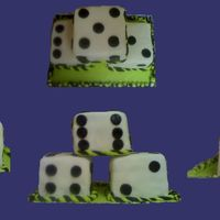 Dice Cake   This cake is comprised of three dice stacked in a pyramid formation.