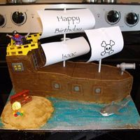 Pirate Ship  For my nephew's 2nd Birthday party. Vanilla cake with vanilla buttercream filling, decorated with banana cream buttercream and pieces...