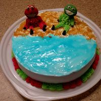 Wilton Course 1 - Class 3   Elmo and Oscar at the beach... I just wasn't feeling the clown cake so I made this for my kids :)