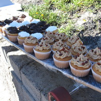 Boardin' Cuppies! from right to left...maple topped with bacon, vanilla, tagalong cookie, chocolate & samoa cookie. in the bright light it was a wilton&#...